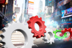 Composite image of white and red cogs and wheels. White and red cogs and wheels against blurry new york street Stock Photos