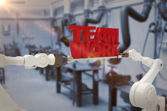 Composite image of white robotic hand holding team work text against white background Stock Image