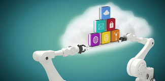 Composite image of white robotic hands holding computer icons against blue background Royalty Free Stock Photography