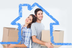 Composite image of wife and husband carrying boxes in their new house Stock Photography