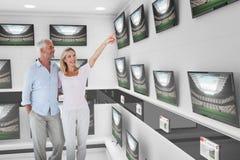 Composite image of wife showing upwards to husband while walking Stock Image