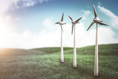 Composite image of wind turbines against white screen 3d. Wind turbines against white screen against green field under blue sky 3d Stock Photos