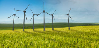 Composite image of windmills side by side against white background 3d Royalty Free Stock Image