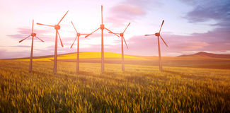 Composite image of windmills side by side against white background 3d Royalty Free Stock Photo
