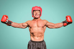 Composite image of winner boxer with arms outstretched Stock Photo