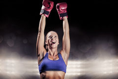 Composite image of winning fighter with arms raised Royalty Free Stock Images
