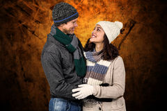Composite image of winter couple enjoying hot drinks Stock Photos