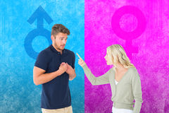 Composite image of woman accusing her guilty looking boyfriend Royalty Free Stock Photos