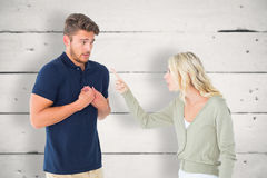 Composite image of woman accusing her guilty looking boyfriend Stock Photos