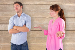 Composite image of woman arguing with uncaring man Royalty Free Stock Images
