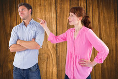 Composite image of woman arguing with uncaring man Royalty Free Stock Photo