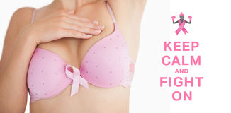 Composite image of woman in bra with breast cancer awareness ribbon Royalty Free Stock Images
