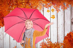 Composite image of woman checking to see if its raining Royalty Free Stock Photo