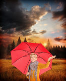 Composite image of woman checking to see if its raining Stock Image