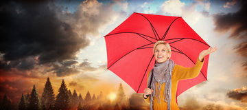 Composite image of woman checking to see if its raining Royalty Free Stock Images