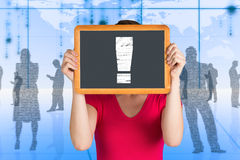 Composite image of woman covering face with chalkboard Stock Images