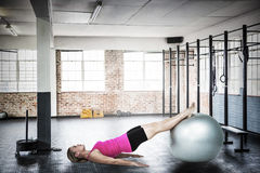 Composite image of woman doing pilates Royalty Free Stock Photos
