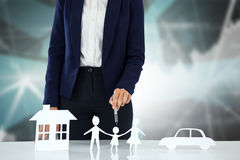 Composite image of woman drawing a car, a family and a house Stock Photography