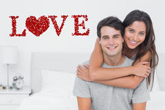 Composite image of woman embracing her partner Royalty Free Stock Photography