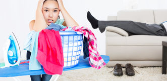 Composite image of woman fed up with ironing Royalty Free Stock Photos