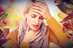 Composite image of woman feeling her forehead for a temperature Royalty Free Stock Photo