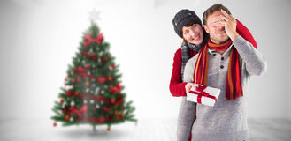 Composite image of woman giving man a present Stock Photos