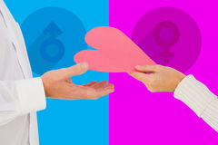 Composite image of woman handing man a paper heart Royalty Free Stock Photography