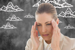 Composite image of woman with headache Royalty Free Stock Photos