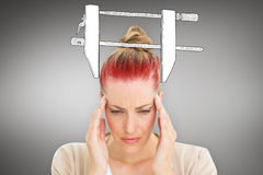 Composite image of woman with headache Royalty Free Stock Images