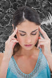 Composite image of woman with headache Royalty Free Stock Photography