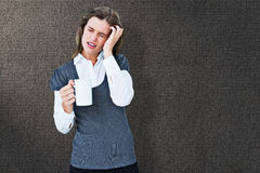 Composite image of woman with headache holding mug Royalty Free Stock Images