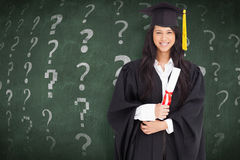 Composite image of woman with her degree dressed in her graduation gown Royalty Free Stock Image