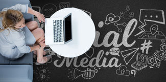Composite image of woman on her laptop Royalty Free Stock Photos