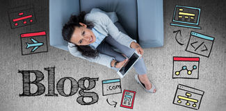 Composite image of woman on her tablet looking up Stock Images
