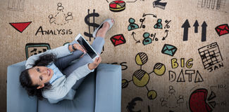 Composite image of woman on her tablet looking up Royalty Free Stock Image