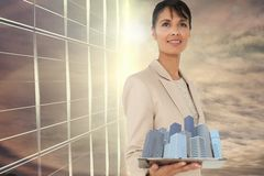Composite image of woman holding buildings in 3d. Digital composite of Composite image of woman holding buildings in 3d vector illustration