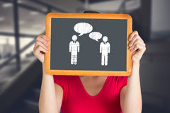 Composite image of woman holding chalkboard over face Royalty Free Stock Photos