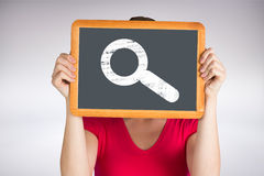 Composite image of woman holding chalkboard over face Royalty Free Stock Image