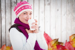 Composite image of woman holding coffee cup Stock Photos