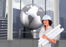 Composite image of woman holding construction plans Stock Images