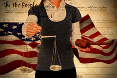 Composite image of woman holding a gavel and scales of justice Royalty Free Stock Photo