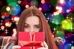 Composite image of woman holding gift Royalty Free Stock Photography