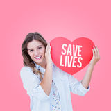 Composite image of woman holding heart card Stock Photos