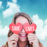 Composite image of woman holding heart cards Stock Photos