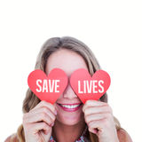 Composite image of woman holding heart cards Royalty Free Stock Photography