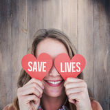 Composite image of woman holding heart cards Royalty Free Stock Photo