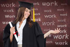 Composite image of a woman holding her hand out with a degree in her other hand as she smiles Royalty Free Stock Images