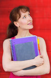 Composite image of woman holding her school notebooks Stock Photography