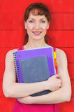 Composite image of woman holding her school notebooks Royalty Free Stock Image