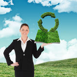 Composite image of woman holding lawn book Stock Photos